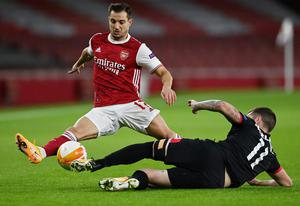 Dundalk's Patrick McEleney puts in a challenge against Arsenal's Cedric Soares. Photo: Reuters