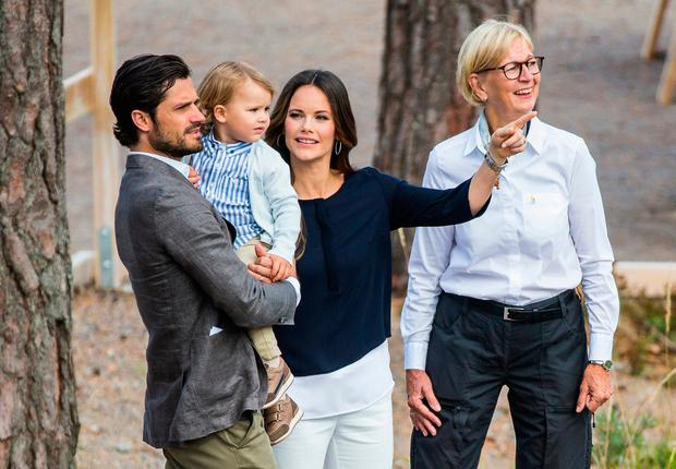 Prince Carl Phillip, Princess Sofia, and Prince Alexander of Sweden attend the inauguration of Prince Alexander's viewpoint at the Nynas Nature Reserve on August 23, 2018 in Gisesjon, Sweden. (Photo by Michael Campanella/Getty Images)