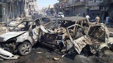 This image posted by the Raqqa Media Center of the Islamic State group, a militant extremist group, shows damaged cars that were burned after a Syrian government airstrike in the northeastern city of Raqqa, Syria. Syria launched a series of airstrikes targeting Raqqa on Saturday, killing dozens of people, most of whom died when one of the missiles slammed into a crowded bakery, activists said. The airstrikes smashed parts of buildings, set cars alight and crushed people under rubble (AP Photo/Raqqa Media Center of the Islamic State group)