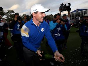 Europe's Rory McIlroy celebrates after winning the Ryder Cup on day three of the 40th Ryder Cup at Gleneagles Golf Course, Perthshire. PRESS ASSOCIATION Photo. Picture date: Sunday September 28, 2014. Photo credit should read: David Davies/PA Wire. RESTRICTIONS: Use subject to restrictions. Editorial use only. No commercial use. Call +44 (0)1158 447447 for further information.