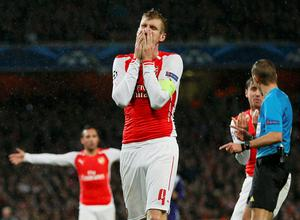 Arsenal's Per Mertesacker reacts after their Champions League soccer match against Anderlecht at the Emirates stadium