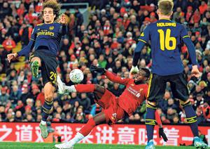 Liverpool's Divock Origi scores his team's fifth goal, his second, during last night's League Cup fourth-round win against Arsenal. Photo: Getty