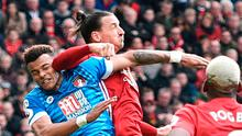 Manchester United's Swedish striker Zlatan Ibrahimovic clashes in the air with Bournemouth's defender Tyrone Mings