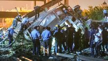 Emergency responders search for passengers following an Amtrak train derailment in the Frankfort section of  Philadelphia, Pennsylvania