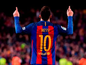 Lionel Messi celebrates after putting Barcelona into the lead against Valencia. Photo: Alex Caparros/Getty Images