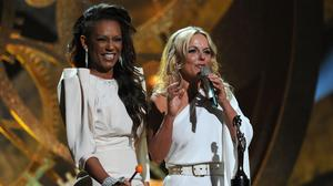 Mel B and Geri Halliwell accept the Spice Girls award for 'Brits Performance of 30 Years' on stage at The Brit Awards 2010 at Earls Court on February 16, 2010 in London, England.  (Photo by Gareth Cattermole/Getty Images)
