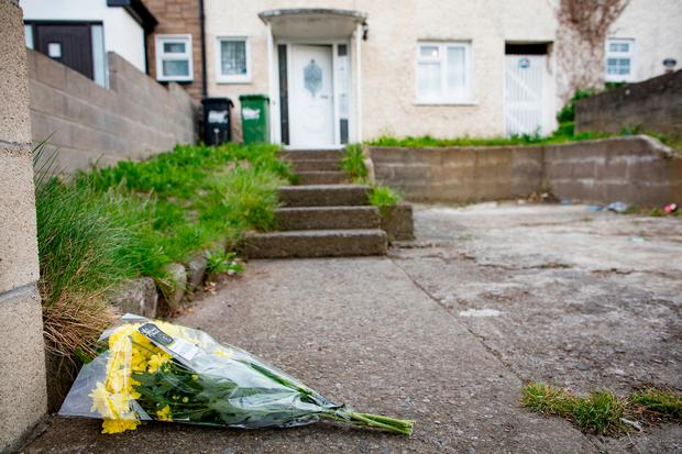 Flowers left outside the house in Mountain View Park where Patricia O'Connor lived. Photo: Arthur Carron