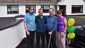 (L-R) Colm Lawlor, Éamonn Lawlor, Dónal Lawlor and Aileen Lawlor outside of their home in Irishtown