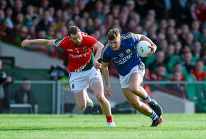 Kerry's James O'Donoghue takes on Mayo's Keith Higgins in one of the most compelling duels in the game in recent times during the All-Ireland SFC semi-final replay at the Gaelic Grounds in Limerick. Photo: Dáire Brennan / SPORTSFILE