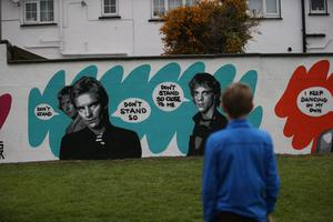 26/04/20 Tadgh Brown(10) pictured walking past artist Emma Blake's mural in Tallaght Co Dublin. Photo: Stephen Collins/Collins Photos