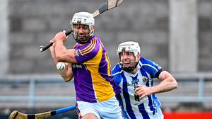 Marc Howard of Kilmacud Crokes shoots to score his side's third goal despite the attentions of Ballyboden's Niall Ryan. Photo: Ramsey Cardy/Sportsfile