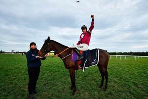 Jack Kennedy celebrates on Apple's Jade after winning the Frank Ward Memorial Hurdle during Day Three of the Leopardstown Christmas Festival last year