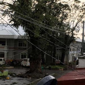 Fallen power lines dangle over buildings after Typhoon Phanfone swept through Tanauan, Leyte, in the Philippines December 25, 2019, in this photo obtained from social media. Paul Cinco/via REUTERS THIS IMAGE HAS BEEN SUPPLIED BY A THIRD PARTY. MANDATORY CREDIT. NO RESALES. NO ARCHIVES.