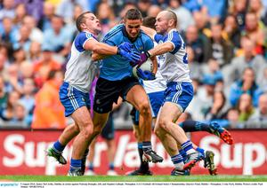 9 August 2014; James McCarthy, Dublin, in action against Padraig Donaghy, left, and Stephen Gollogly, Monaghan. GAA Football All-Ireland Senior Championship, Quarter-Final, Dublin v Monaghan, Croke Park, Dublin. Picture credit: Paul Mohan / SPORTSFILE