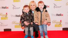 Karen Koster pictured with her children Finn and JJ at the opening night of The Helix Pantomime, Beauty and the Beast. Picture: Leon Farrell/Photocall Ireland