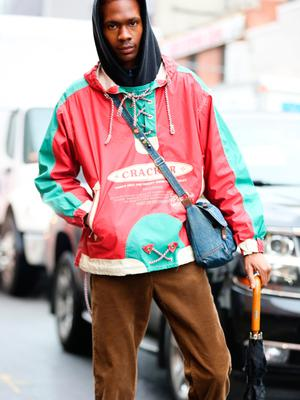 A guest is seen wearing a red and light green thrift jacket with a blue bag and brown pants outside of the Coach 1941 show during New York Fashion Week on February 11, 2020 in New York City. (Photo by Donell Woodson/Getty Images)