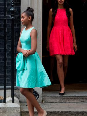 Sasha (left) and Malia Obama leave 10 Downing Street, London, after a visit. PRESS ASSOCIATION Photo. Picture date: Tuesday June 16, 2015. Michelle Obama is visiting Britain to discuss her campaigns for girls' education and better support for military families. See PA story POLITICS Obama. Photo credit should read: Stefan Rousseau/PA Wire