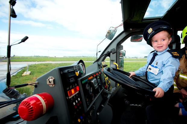 Garda Ceejay McArdle as the Shannon Airport Police Fire Service give an amazing display for the visitors.