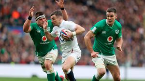 England's George Ford gets away from Ireland's CJ Stander during the Guinness Six Nations match at Twickenham Stadium, London. Photo: David Davies/PA Wire