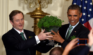 Enda Kenny and Barack Obama taking part in the traditional shamrock-giving ceremony in the White House