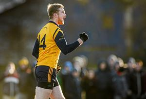 Conor McGraynor, Dublin City University, celebrates after scoring a goal for his side