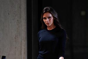 Victoria Beckham walks the runway at her show