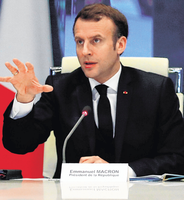 French President Emmanuel Macron gestures as he addresses a meeting at the emergency crisis centre of the Interior Ministry in Paris yesterday as France tackles the coronavirus. Photo: Getty Images