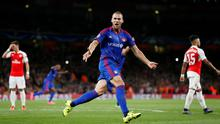 Pajtim Kasami celebrates after Arsenal's David Ospina scored an own goal and the second goal for Olympiacos