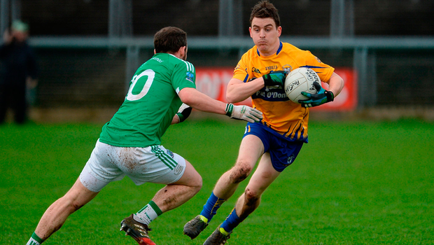 Martin McMahon of Clare in action against Paul McCusker of Fermanagh. Photo by Oliver McVeigh/Sportsfile