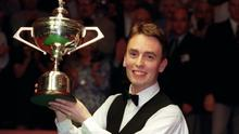 Ken Doherty celebrates his World Snooker Championship final victory over Stephen Hendry at the Crucible Theatre in Sheffield on May 5, 1997