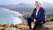End of the line: Sean O'Rourke on Killiney Hill overlooking Dublin Bay after announcing his retirement from his morning radio show. Photo: Steve Humphreys