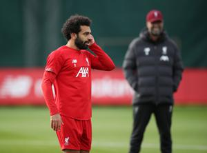 Liverpool's Mohamed Salah and Liverpool manager Juergen Klopp during training at Melwood yesterday. Photo: Reuters/Carl Recine