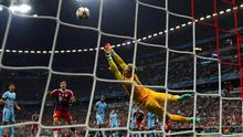 Manchester City goalkeeper Joe Hart fails to stop Jerome Boateng's shot in the final minutes of the Champions League game against Bayern Munich at the Allianz Arena. Photo: REUTERS/Michael Dalder