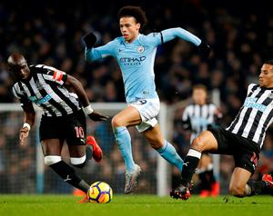 Manchester City's Leroy Sane gets away from the Newcastle United defence. Photo: Martin Rickett/PA Wire
