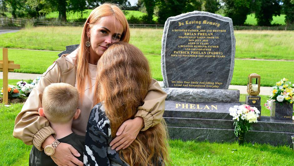 Amanda O'Riordan with her two children yesterday at the grave of their father Brian Phelan