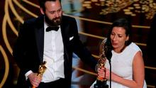"""Benjamin Cleary and Serena Armitage accept the award for Best Live Action Short Film for """"Stutterer"""" at the 88th Academy Awards in Hollywood, California February 28, 2016.  REUTERS/Mario Anzuoni"""