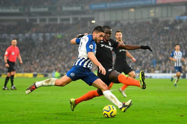 Neal Maupay of Brighton and Hove Albion crosses the ball under pressure from Kurt Zouma of Chelsea. Photo by Mike Hewitt/Getty Images