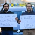20/01/2020 (L to R) Adeel Butt from Lucan & Lakhbir Singh from Clondalkin during a Taxi Drivers Protest at Free Now offices on mount Street, Dublin. Photo: Gareth Chaney/Collins