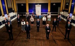 President Michael D Higgins with the new Cabinet last night. Front row: Eamon Ryan, Taoiseach Micheal Martin, President Higgins, Tánaiste Leo Varadkar. Second row: Simon Coveney, Catherine Martin, Paschal Donohoe, Michael McGrath, Darragh O'Brien. Third row: Helen McEntee, Roderic O'Gorman, Heather Humphreys, Norma Foley, Barry Cowen, Simon Harris. Fourth row: attorney general Paul Gallagher, Chief Whip Dara Calleary, Stephen Donnelly, Pippa Hackett, Hildegarde Naughten. Photo: Maxwells