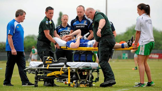 20 June 2015; Rory Dunne, Cavan, is helped onto a stretcher after sustaining an injury. GAA Football All-Ireland Senior Championship, Round 1A, London v Cavan, Páirc Smárgaid, Ruislip, London, England. Picture credit: Seb Daly / SPORTSFILE