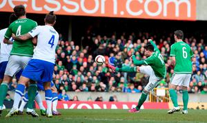 Northern Ireland's Kyle Lafferty scores his teams first goal against Finland, during the UEFA Euro 2016 Qualifier at Windsor Park, Belfast. PRESS ASSOCIATION Photo. Picture date: Sunday March 29, 2015. See PA story SOCCER N Ireland. Photo credit should read: Martin Rickett/PA Wire