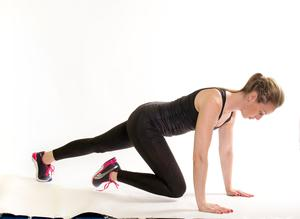Mountain climber:  2/ Slowly bring one knee up to the chest and then return back to start position.