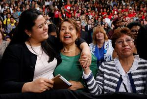 Lorella Praeli, Chela Praeli and Ligia Jimenez (L-R) listen to U.S. President Barack Obama speak about immigration reform, but John Cunningham (35), from Donegal but living in Boston for almost 16 years, says there is nothing in the new reforms for undocumented Irish like him and the heartbreak of missing funerals, weddings and other occasions is likely to continue (REUTERS/Kevin Lamarque)
