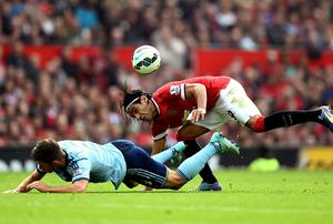 Radamel Falcao García of Manchester United and Aaron Cresswell of West Ham compete for the ball