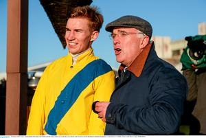18 January 2015; Jockey Adrian Heskin with trainer Ted Walsh watch the replay of their race on the big screen after he rode Foxrock to win the BoyleSports Handicap Steeplechase. Leopardstown, Co. Dublin. Picture credit: Barry Cregg / SPORTSFILE