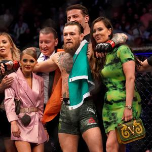 Conor McGregor celebrates his win against Donald Cerrone with Dee Devlin and family