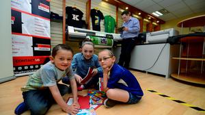 Chris McGillycuddy at work in Killorglin with his children (left to right) Fionn (5), Lucy (10) and Sally (6). Photo: Domnick Walsh
