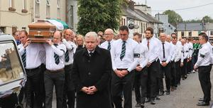 The remains of Det Garda Colm Horkan remains are carried through the town.  Picture; Gerry Mooney