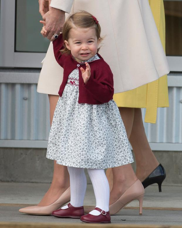 Princess Charlotte waves prior to getting on a float plane as Britain's Royal family prepares to depart Victoria, British Columbia, Saturday, Oct. 1, 2016. (Jonathan Hayward/The Canadian Press via AP)