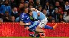 Manchester City's Edin Dzeko tangles with Chelsea's David Luiz